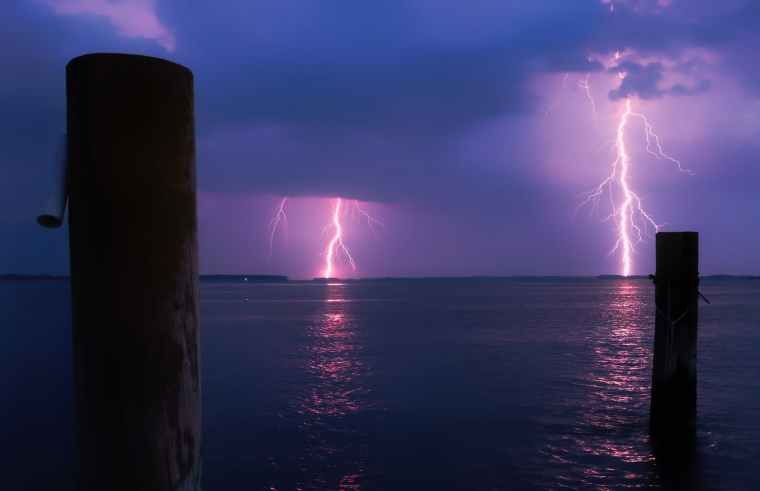 lightning over sea against storm clouds
